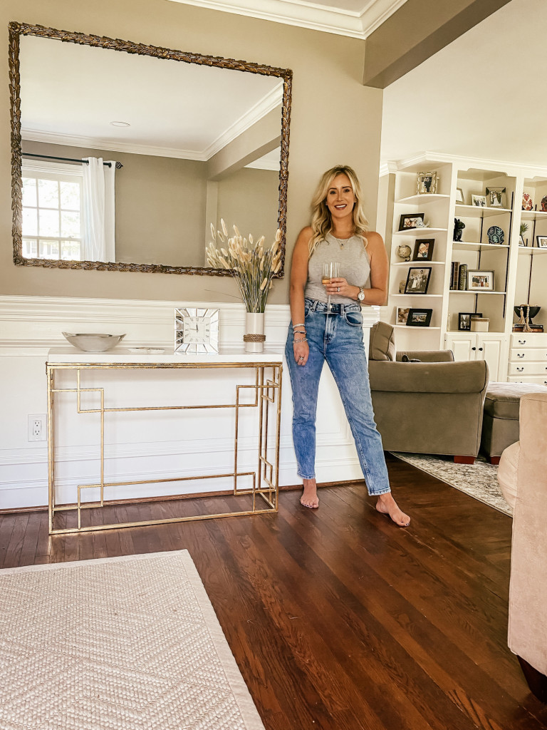 woman in jeans in newly renovated room